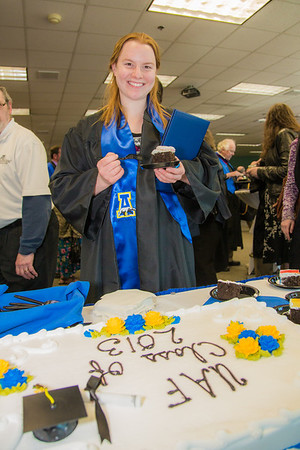 Meghan O'Leary, who graduated with a BA in biological sciences, enjoys a piece of chocolate cake, courtesy of the UAF Alumni Association, after the ceremony.  Filename: GRA-13-3827-1280.jpg