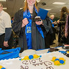 "Meghan O'Leary, who graduated with a BA in biological sciences, enjoys a piece of chocolate cake, courtesy of the UAF Alumni Association, after the ceremony.  <div class=""ss-paypal-button"">Filename: GRA-13-3827-1280.jpg</div><div class=""ss-paypal-button-end"" style=""""></div>"
