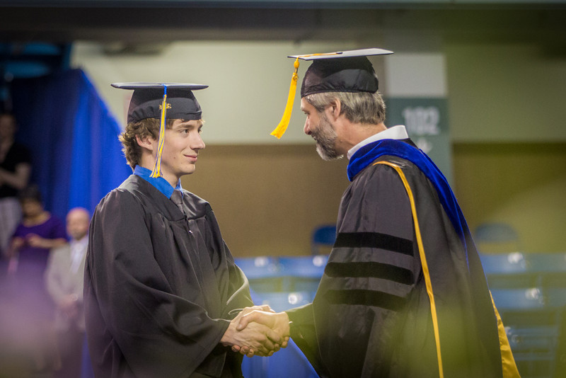 "Michael Stanfill shakes hands with dean Doug Goering before accepting his bachelor of science degree in mechanical engineering.  <div class=""ss-paypal-button"">Filename: GRA-14-4186-0440.jpg</div><div class=""ss-paypal-button-end"" style=""""></div>"