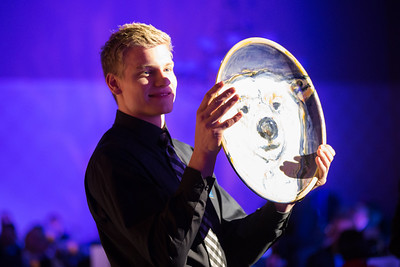 Hockey player Colton Parayko presents a bowl for auction at the 2014 Chancellors Gala at the Westmark Ballroom in downtown Fairbanks.  Filename: DEV-14-4063-305.jpg