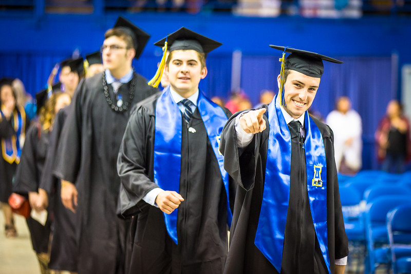 """Alec Hajdukovich is all smiles during the 2016 commencement ceremony processional at the Carlson Center.  <div class=""""ss-paypal-button"""">Filename: GRA-16-4896-374.jpg</div><div class=""""ss-paypal-button-end""""></div>"""