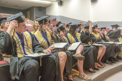 Graduates from UAF's Honors Program move their tassles at the conclusion of their commencement ceremony May 10 in Schaible Hall on the Fairbanks campus.  Filename: GRA-14-4183-182.jpg