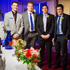 """Alaska Nanooks Hockey players, from left,  Garrick Perry, Nolan Kaiser, alumnus Kaare Odegard and Alec Hajdukovich greet and seat guests at the 2014 Chancellor's Gala.  <div class=""""ss-paypal-button"""">Filename: DEV-14-4063-75.jpg</div><div class=""""ss-paypal-button-end""""></div>"""