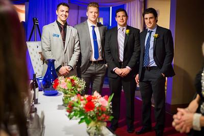 Alaska Nanooks Hockey players, from left,  Garrick Perry, Nolan Kaiser, alumnus Kaare Odegard and Alec Hajdukovich greet and seat guests at the 2014 Chancellor's Gala.  Filename: DEV-14-4063-75.jpg