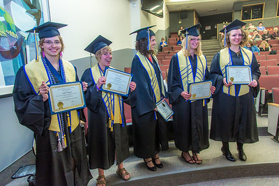 Members of the Honors Program class of 2014 stand after receiving their diplomas during their commencement ceremony May 10 in Schaible Hall.  Filename: GRA-14-4183-94.jpg