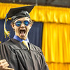 "Ryan Cudo shows a flash of exuberance after accepting his bachelor of science degree in civil engineering.  <div class=""ss-paypal-button"">Filename: GRA-14-4186-0453.jpg</div><div class=""ss-paypal-button-end"" style=""""></div>"
