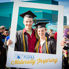 """Graduates surrounded by friends and family pose for a photo after the 2016 commencement ceremony outside the Carlson Center.  <div class=""""ss-paypal-button"""">Filename: GRA-16-4895-149.jpg</div><div class=""""ss-paypal-button-end""""></div>"""