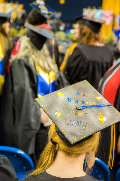"""A graduate displays a personal message on her cap during UAF's commencement ceremony May 11 in the Carlson Center.  <div class=""""ss-paypal-button"""">Filename: GRA-14-4186-0707.jpg</div><div class=""""ss-paypal-button-end"""" style=""""""""></div>"""