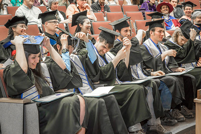 Graduates from UAF's Honors Program move their tassles during their commencement ceremony in Schaible Auditorium.  Filename: GRA-13-3825-147.jpg