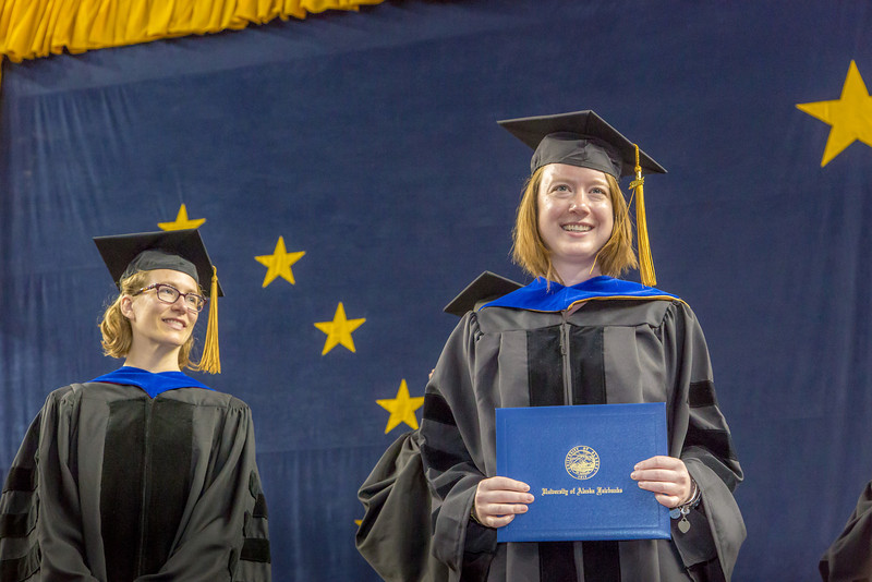 """Mary-Catherine Christina Leewis is all smiles after being awarded her Ph.D in biological sciences under the tutelage of Dr. Mary Beth Leigh at left.  <div class=""""ss-paypal-button"""">Filename: GRA-14-4186-0954.jpg</div><div class=""""ss-paypal-button-end"""" style=""""""""></div>"""