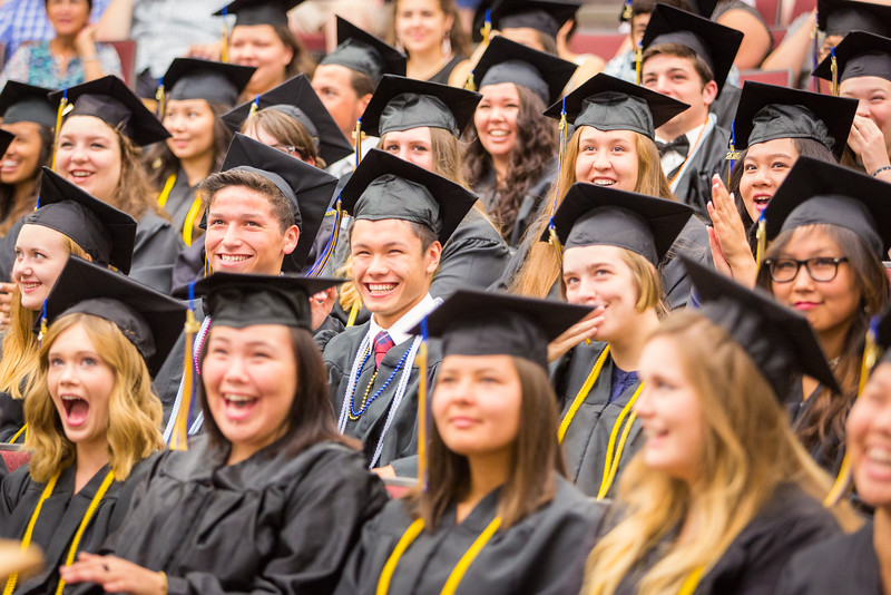 """Participants in UAF's 2016 Rural Alaska Honors Institute react to Academic Coordinator Greg Owens' remarks at the graduation ceremony in Schaible Auditorium.  <div class=""""ss-paypal-button"""">Filename: GRA-16-4932-65.jpg</div><div class=""""ss-paypal-button-end""""></div>"""