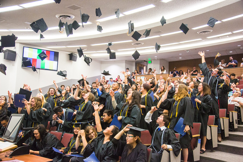 """Participants in UAF's 2016 Rural Alaska Honors Institute toss their caps after the conclusion of their graduation ceremony at the Schaible Auditorium.  <div class=""""ss-paypal-button"""">Filename: GRA-16-4932-157.jpg</div><div class=""""ss-paypal-button-end""""></div>"""