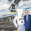 "UAF Athletic Director Gary Gray posed with a good friend by the Era Alaska newly painted Bombardier Dash-8 which features the Alaska Nanooks colors and logo on one side, and a UAA Seawolves treatment on the other.  <div class=""ss-paypal-button"">Filename: DEV-13-3858-151.jpg</div><div class=""ss-paypal-button-end"" style=""""></div>"