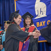 """Graduates receive congratulatory handshakes from UAF officials during the  Bristol Bay campus 2012 commencement ceremony in Dillingham.  <div class=""""ss-paypal-button"""">Filename: GRA-12-3391-339.jpg</div><div class=""""ss-paypal-button-end"""" style=""""""""></div>"""