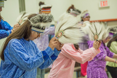 Members of a local high school Native dance ensemble perform during the 2012 commencement ceremony for UAF's Bristol Bay Campus in Dillingham.  Filename: GRA-12-3391-146.jpg
