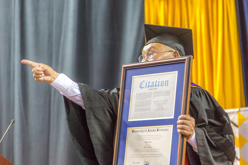 """Honorary Doctor of Laws recipient Robert Nick points to family members in the crowd after receiving his formal citation.  <div class=""""ss-paypal-button"""">Filename: GRA-14-4186-1183.jpg</div><div class=""""ss-paypal-button-end"""" style=""""""""></div>"""