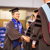 "Hockey player JD Peterson is congratulated during the commencement ceremony, Sunday, May 8, 2016 at the Carlson Center. Peterson received a Bachelor of Arts degree in communication.  <div class=""ss-paypal-button"">Filename: GRA-16-4896-963.jpg</div><div class=""ss-paypal-button-end""></div>"