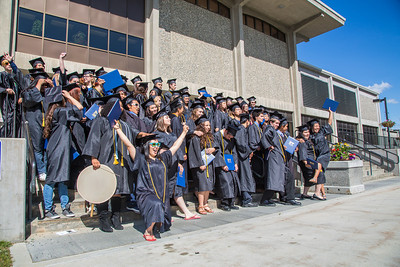 Members of the 30th anniversary graduating class of UAF's Rural Alaska Honors Institute celebrate on the steps of the Rasmuson Library moments after their commencement ceremony July 11.  Filename: GRA-12-3466-208.jpg