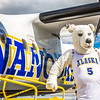 "The Nanook mascot stands by the Era Alaska newly painted Bombardier Dash-8 which features the Alaska Nanooks colors and logo on one side, and a UAA Seawolves treatment on the other.  <div class=""ss-paypal-button"">Filename: DEV-13-3858-71.jpg</div><div class=""ss-paypal-button-end"" style=""""></div>"