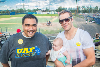 UAF Alumni Association board member Mike Campbell poses with fellow alum and former Nanook Jordan Henry during the annual UAF Alumni Night with the Alaska Goldpanners at Growden Field on July 22.  Filename: DEV-15-4583-27.jpg
