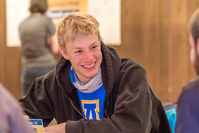 UAF scholarship recipient Logan Hanneman takes some time of his schedule to write a thank you note during thank-a-donor day in the Wood Center ballroom.  Filename: DEV-13-3726-15.jpg