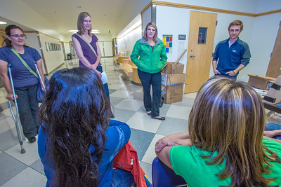 Marisa Sharrah (in green jacket), public affairs officer with Flint Hills Resources, visits with students attending the Alaska Summer Research Academy (ASRA) in the Reichardt Building on the Fairbanks campus. Flint Hills has been a long time supporter of the program.  Filename: DEV-12-3473-036.jpg