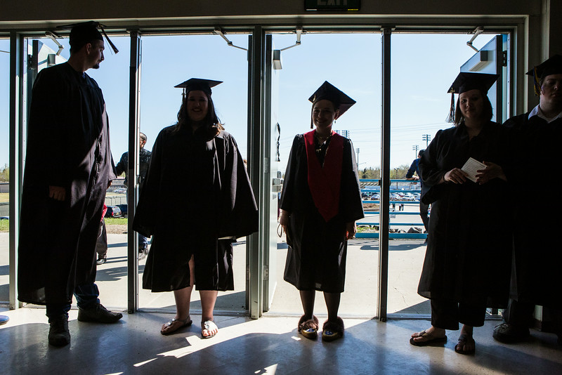 "Graduates line up before the 2014 Commencement Ceremony at the Carlson Center.  <div class=""ss-paypal-button"">Filename: GRA-14-4187-33.jpg</div><div class=""ss-paypal-button-end""></div>"
