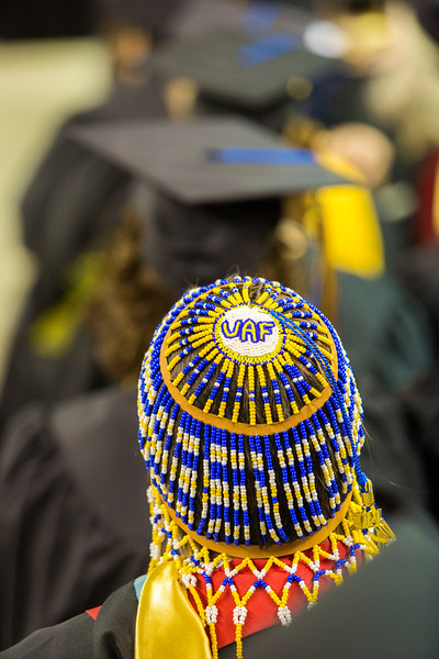 """Social work graduate Tonya Esmailka wore some unique headgear during UAF's commencement ceremony May 11 in the Carlson Center.  <div class=""""ss-paypal-button"""">Filename: GRA-14-4186-0700.jpg</div><div class=""""ss-paypal-button-end"""" style=""""""""></div>"""