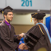 "Milaud Baumgartner accepts his degree in mechanical engineering during UAF's commencement ceremony May 11 in the Carlson Center.  <div class=""ss-paypal-button"">Filename: GRA-14-4186-0368.jpg</div><div class=""ss-paypal-button-end"" style=""""></div>"