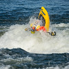 Eric Jackson, founder of Jackson Kayaks, throws a Front Loop for the crowd.