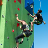 #251 Sarah Frank from Boise and #220 Aiden O'Gara from Eagle compete in the Seep Climbing event on the 30' wall.