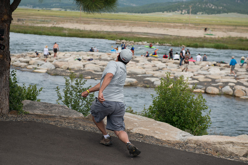 1st Placw Pro Men's Disc Golf sends a disc across the river, the island, and more river.