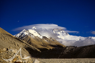 Lenticular clouds and high winds obscure the North Face of Mount Everest from Rongbuk Basecamp, Tibet.
