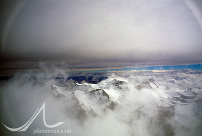 A stormy morning looking north over the peaks of the Tibetan Himalaya from the North Ridge of Mount Everest, Tibet.