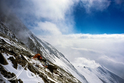 A lone tent perched at 27,200 foot Camp VI on the North Face of Mount Everest, Tibet. The West Ridge is clearly visible behind.