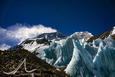 Mount Everest rises high above the icy seracs of the East Rongbuk Glacier, Tibet.