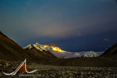 Sunset paints the north face of Mount Everest from a quiet Rongbuk Basecamp, Tibet.