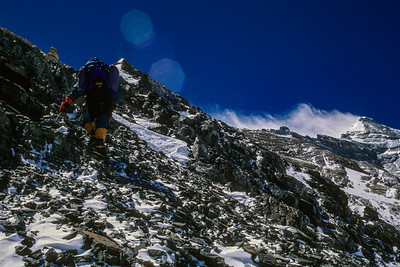 Climbing the North Ridge of Mount Everest off the normal route above Camp V and looking for the 1924 Camp VI, which was found by Jake Norton and Brent Okita on that day. This is a similar location and view to Noel Odell's famed final view of George Mallory and Andrew Irvine on June 8, 1924, before they disappeared into the mist.