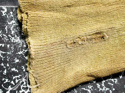 """The lost sock of Edward Felix """"Teddy"""" Norton, recovered by Jake Norton from the tattered remains of the 1924 Camp VI at 27,000 feet on the North Ridge of Mount Everest, Tibet."""