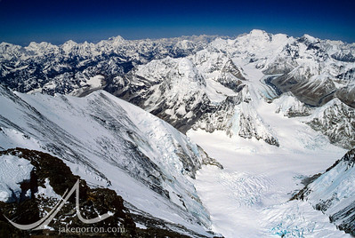 Looking down from the North Face of Mount Everest at the Central Rongbuk and West Rongbuk Glaciers, past peaks of Pumori, Lingtren, Tongqiang, Qomosam Zhubma, and on to Gyanchung Kang and Cho Oyu.