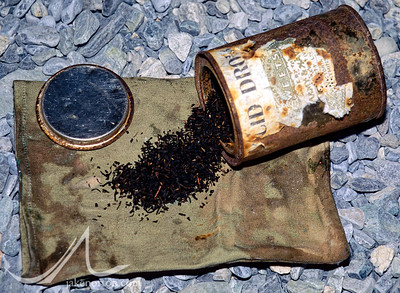 A tin can full of loose-leaf tea, recovered by Jake Norton from the tattered remains of the 1924 Camp VI at 27,000 feet on the North Ridge of Mount Everest, Tibet.