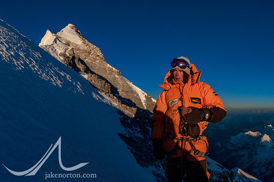 Ted Mahon enjoys the splendor of sunrise from Mushroom Rock, 28,250 feet, on Everest's Northeast Ridge, Tibet.