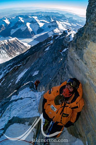 Jesse Rickert approaches the base of the famed Second Step at 28,350 feet on Everest's Northeast Ridge, Tibet. Ted Mahon is topping out on the Corkscrew Chimney below.