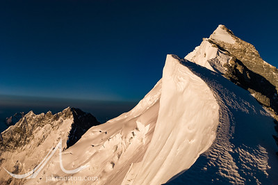 Gazing up the sweeping cornices and rock steps of Mount Everest's Northeast Ridge from Mushroom Rock at 28,300 feet. Lhotse rises behind and left.
