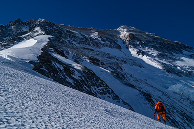 Mark Whetu climbs the North Ridge of Mount Everest, Tibet, with the upper North Face of the mountain visible above.