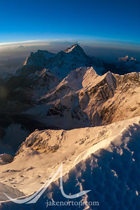 Looking east at sunrise toward Makalu and Kangchenjunga from near Mushroom Rock on the Northeast Ridge of Mount Everest, Tibet.