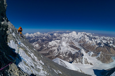 Climber Phuru Sherpa at 28,750 feet on Everest's Northeast Ridge Route, Tibet. Pumori, Cho Oyu, Gyachung Kang, Shishapangma and the crest of the Great Himalaya rise in the distance.