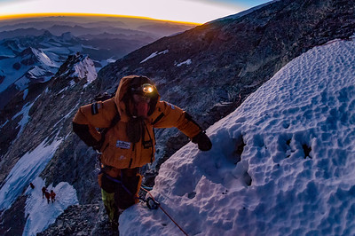 Jesse Rickert tops out on the First Step on the Northeast Ridge of Mount Everest. The top of the Pinnacles are clearly visible behind, and Kellas Rock Peak (Lixin) rises behind.