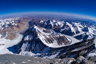 Looking north from 28,750 feet on the North Face of Everest, just below the Dihedrals and the final summit slopes. Clearly visible, from R to L, are the Northeast Ridge crest with Lhakpa Ri and Khartaphu behind; the East Rongbuk Glacier, the North Col, Kellas Rock Peak, Changtse, Chang Zheng peak, the Central Rongbuk Glacier, and the Rongbuk Valley heading north.