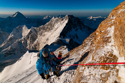 Climbers work their way through steep rock bands below the South Summit of Mount Everest. Lhotse and Makalu rise behind.